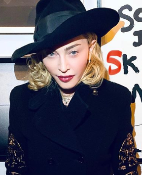 Madonna being sued by a fan for showing up tardily at concerts