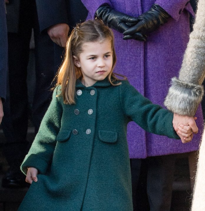 Princess Charlotte stole the show when she hugs the royal fan in a wheelchair