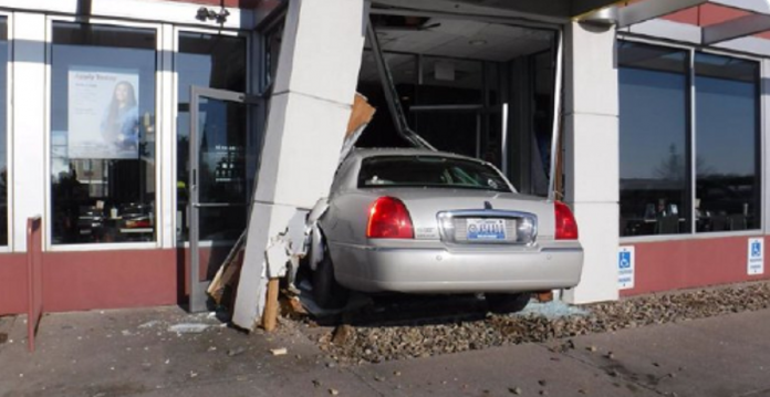 Woman crashes her vehicle into McDonald's