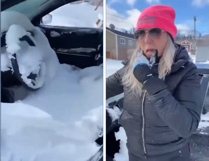 Canadian woman wakes with car full of snow