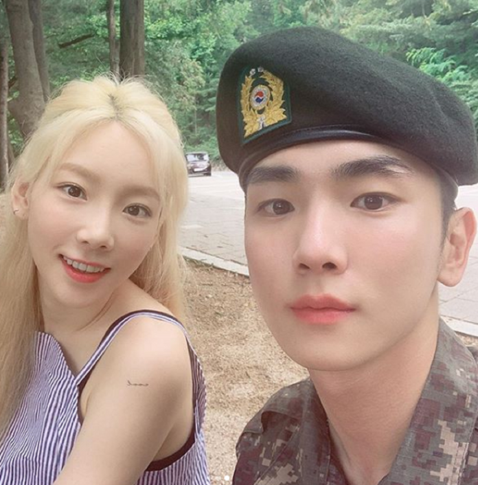 Taeyeon from Girls Generation pays Shinee's key a visit at his army base