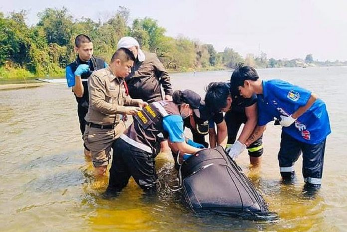 Chinese couple were tied up in a suitcase and dumped into the river while still Alive