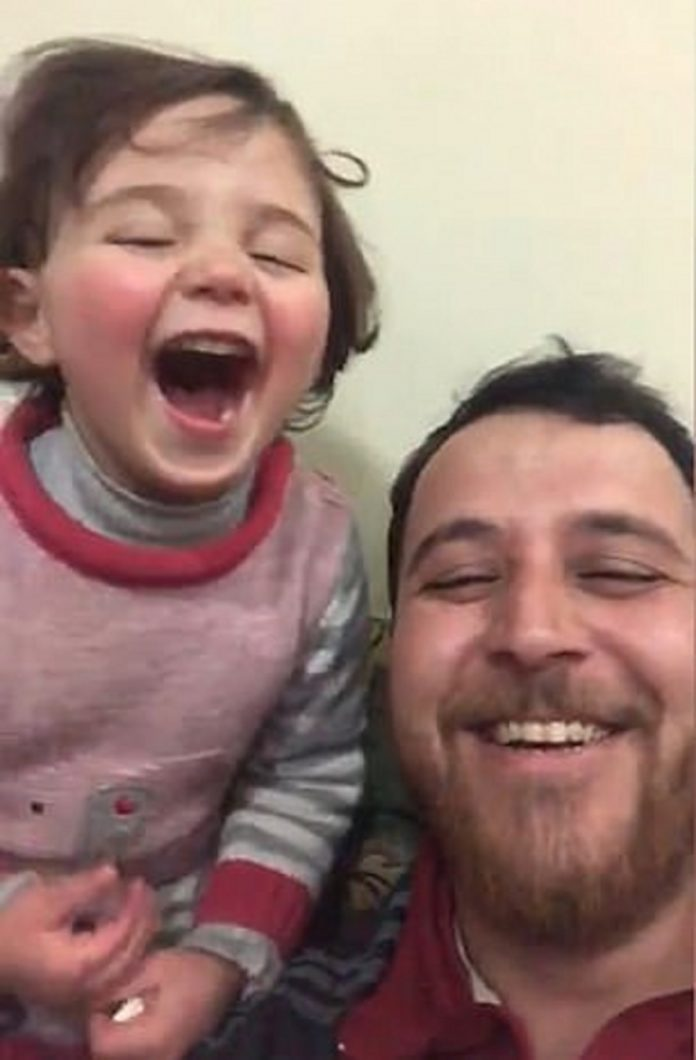 Viral video shows a little girl unafraid of bombing after father made 'laughing game'