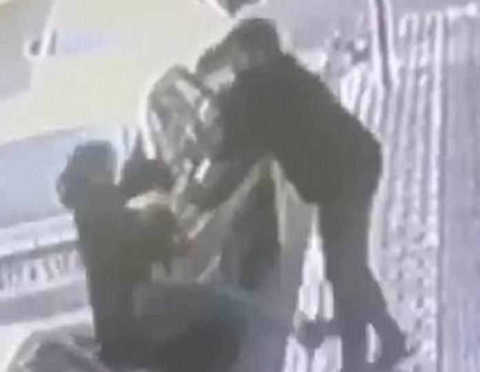 Footage shows bearded man harassing the veiled woman on a pavement