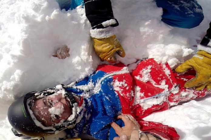 Dramatic video shows rescue of female skier who was trapped in the snow